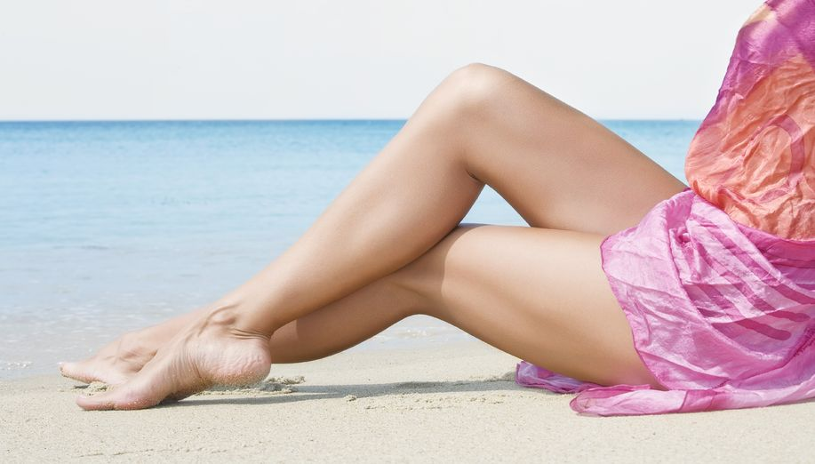 nice smooth womans legs on beach